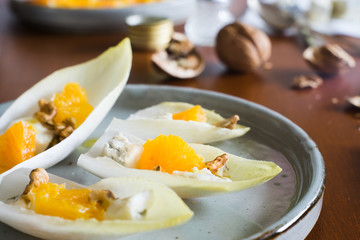Belgian endive leaves with orange, blue cheese and walnuts