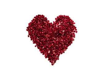 Red berries of a pomegranate in a heart shape