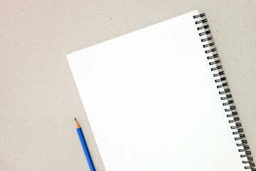 Top view of blank notebook on paper background