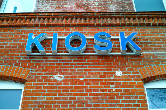Kiosk sign on a brick facade of a building.Munich,Germany