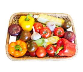 Basket with fresh vegetables, isolated on white background