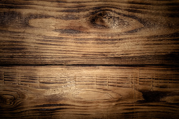 Old wooden burned table or board for background. Space for text.