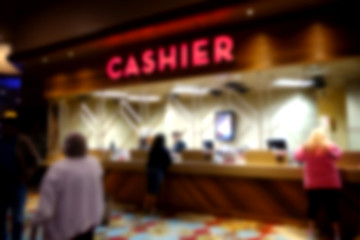 blurred background of cashier cage at casino