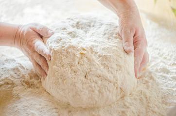 Woman is preparing dough