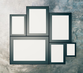Blank black picture frames on concrete wall, mock up, 3D Render
