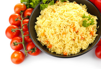 Dish of rice with vegetables isolated on white