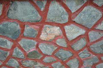 Stone wall with dark red seam