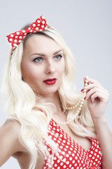 Pinup Style and Concepts. Sexy Sensual Caucasian Blond Woman in Pin up Dress