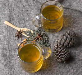 cups of green tea with the pine cones on the table