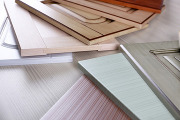 Samples of wooden panels for furniture and door on light table