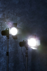 Studio light flashes on wall grey textured background