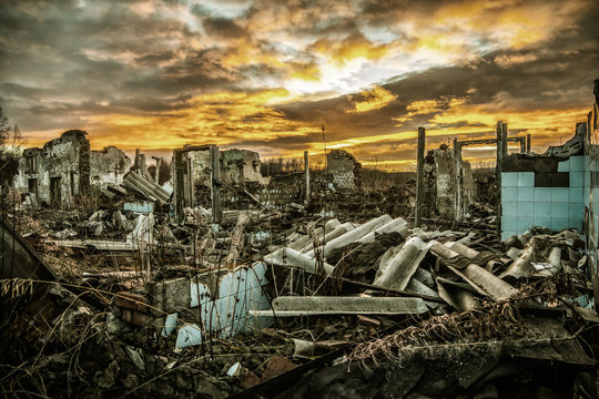 Apocalyptic landscape.The remains of destroyed houses at sunset