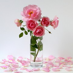 Romantic floral still life with bouquet of pink roses in a vase.