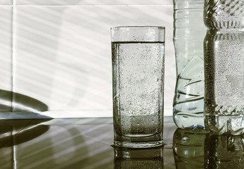 The water in the glass and the rays of light.