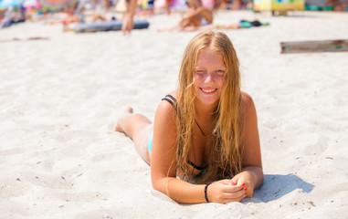 Happy girl enjoying sunny day at the beach