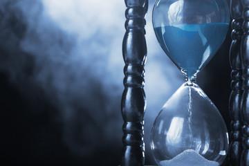Hourglass clock and smoke