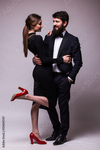 Portrait Of Young Couple In Love Posing Dressed In Classic Clothes