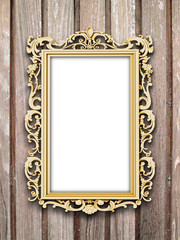 Close-up of one golden baroque picture frame on vertical brown wooden boards background