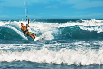 Water Sports. Kiteboarding, Kitesurfing. Surfer Man Surfing On Waves In Ocean, Sea. Extreme Sport Action. Recreational Sporting Activity. Healthy Active Lifestyle. Summer Fun Adventure. Hobby