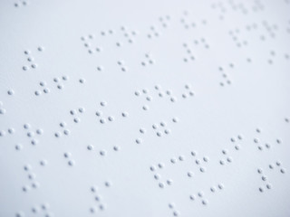 Close up of braille text paper.