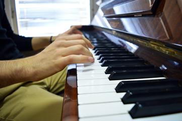 Piano player close up
