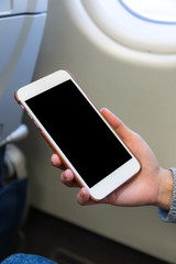 Woman use of mobile phone in plane