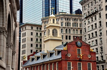 Boston, Massachusetts - July 13, 2013:  The historic 1713 Old State House at the corner of State and Washington Streets is a landmark site on the Freedom Trail