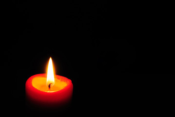 Red candle light with black background