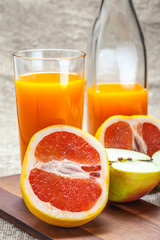 Juice of apples and red grapefruit.