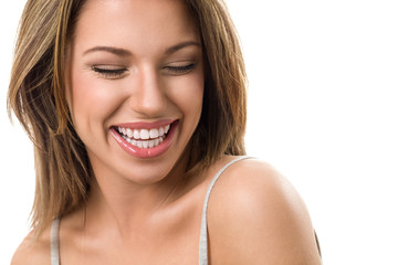Young candid woman laughing