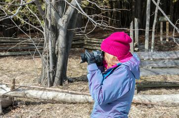 Woman taking photos near frozen Lake Champlain