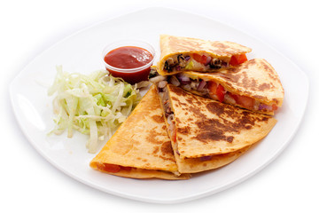 Quesadillas cut into four pieces with ketchup