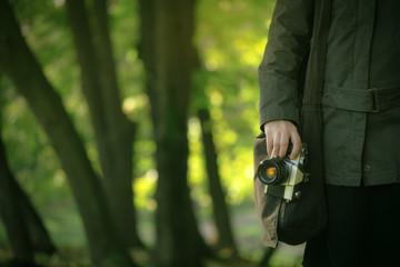 Hipster female photographer exploring spring nature landscapes