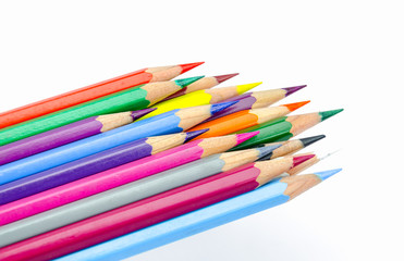 Many colored wooden pencils on white.