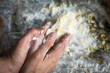 Man mixing flour and eggs