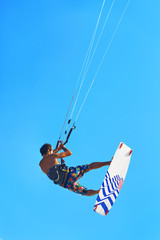 Kiteboarding, Kitesurfing. Water Sports. Professional Kite Surfer In Action In Air. Extreme Sport In Ocean. Healthy Active Lifestyle. Recreational Sporting Activity. Summer Fun, Hobby. Adrenaline.