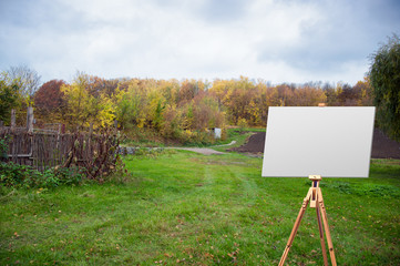 easel on the background of the field