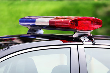 police car with siren light closeup