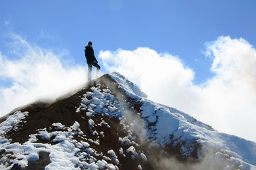 Climber stands on the summit of Avacha volcano