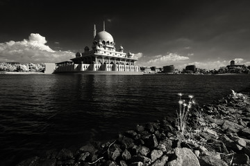 Mosque of Putra at Putrajaya, Melaya in high contrast monochrome infrared image. Soft focus due to use of infrared converted camera. Slight coffee colored tint added to the image.