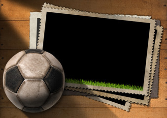 Football - Old Photo Frames with Soccer Ball / A stack of old vintage and blank photo frames with an old soccer ball (football). On a wooden background