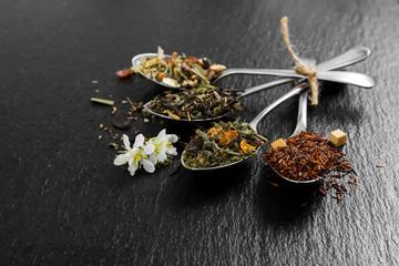 Aromatic flower tea in metal spoon
