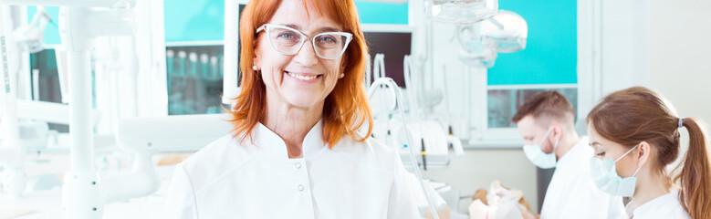 Older smiling stomatology professor on classes