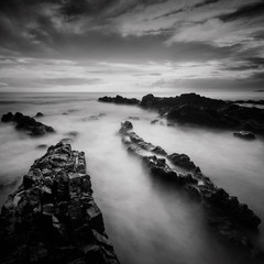 Long exposure and black and white image of Rocky Beach.Slightly noise and soft focus.