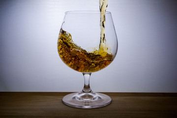 Wall Mural - splash liquid in glass of brandy