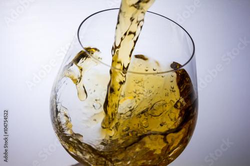 Wall mural splash in glass of cognac