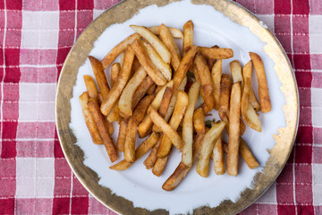 Top view of plate with fresh fryed french fries