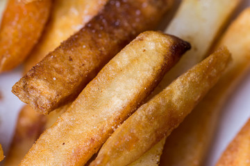 Close macro view of french fries on the plate