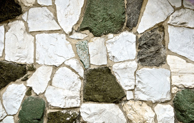 Earth tone Cement stone wall texture grunge. Concrete puzzle. Green earthy natural color for background. Close up.