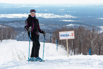 Girl skier on top of a mountain